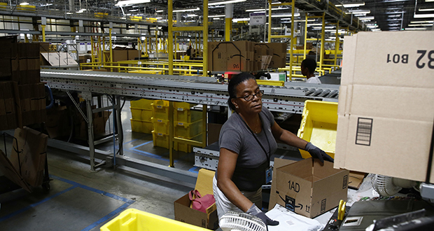 Myrtice Harris packages products for shipment Aug. 3 at an Amazon fulfillment center in Baltimore. (AP Photo: Patrick Semansky)