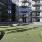 Outside, a patio offers a grilling area, a fire pit, a bar, a putting green and a swimming pool.