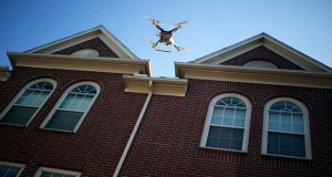 A Da-Jiang Innovations Science and Technology Co. Phantom drone is flown Sept. 6 during a property inspection following Hurricane Harvey in Houston. President Donald Trump on Wednesday signed an executive order designed to speed the approval of drone flights over crowds and for longer distances. (Bloomberg file photo)