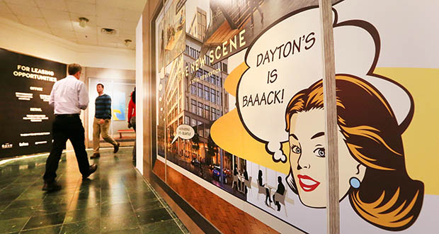 Skyway pedestrians walk by eye-catching signage Tuesday within the historic Dayton's complex at 700 Nicollet Mall in downtown Minneapolis.  (Staff photo: Bill Klotz)