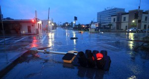A traffic signal toppled by the winds of Hurricane Harvey lies in an intersection of downtown Corpus Christi, Texas, on Aug. 26. Corpus Christi is the site of a pilot project for the RELi resilience construction standard developed by the Minneapolis office of the Perkins + Will. A hospital for Christus Spohn Health System is being built with hurricane-resistant panels, large roof drains, rain gardens and green roofs. (AP file photo: Corpus Christi Caller-Times)