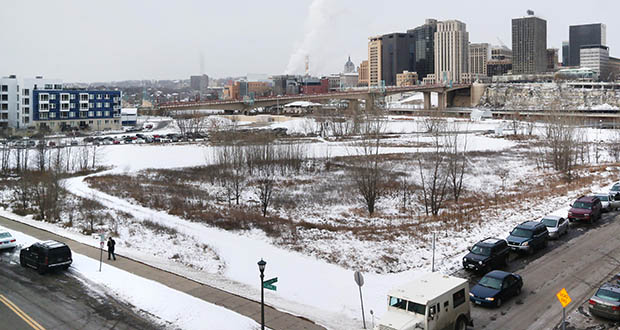 Minneapolis-based Sherman Associates' West Side Flats Phase III development will rise on this snow-covered site bordered by the Mississippi River, Livingston Street, Fillmore Avenue and the Union Pacific Railroad tracks. (Staff photo: Bill Klotz)
