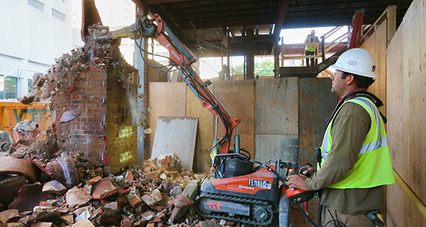 McGough employee Nick Edwards operates a demolition robot at the former Woolworths building at 428 Minnesota St. in downtown St. Paul. (Staff photo: Bill Klotz)