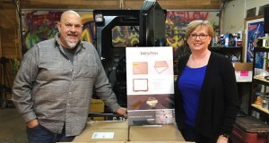 Greg and Betsy Amundson stand next to a pallet of InstaTrim. Pallets of the InstaTrim product are shipped from the Amundson's home-based business, CornerFlex, in Scandia (Submitted photo)