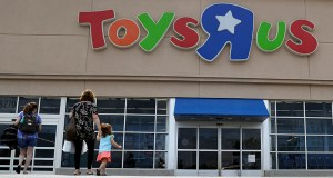 Shoppers walk into a Toys R Us store in San Antonio, Texas. Toys R Us says it will be closing some U.S. stores and converting others to cobranded locations as it continues to deal with its financial restructuring following its bankruptcy filing. (AP file photo)