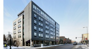 The 48,000-square-foot Moxy Minneapolis Uptown Hotel at 1121 W. Lake St. has a dark metallic exterior on Lake Street and a softer brick backside. (Staff photo: Bill Klotz)