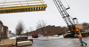 A metal staircase is lifted into position by a crane March 5 to provide access from 38th Street down to the surface of Interstate 35W in Minneapolis. The area is part of the $239 million revamp of I-35W from 46th Street to Interstate 94, which is part of the Minnesota Department of Transportation's 2018 construction season. (Staff photo: Bill Klotz)
