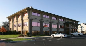 The longtime owners of the Oak Ridge Centre office building, at 4801 Highway 61 N. in White Bear Lake, have sold it to new investors. Among the tenants: Coldwell Banker Burnet, Burnet Title and the White Bear Lake Area Chamber of Commerce. (Submitted photo: CoStar)