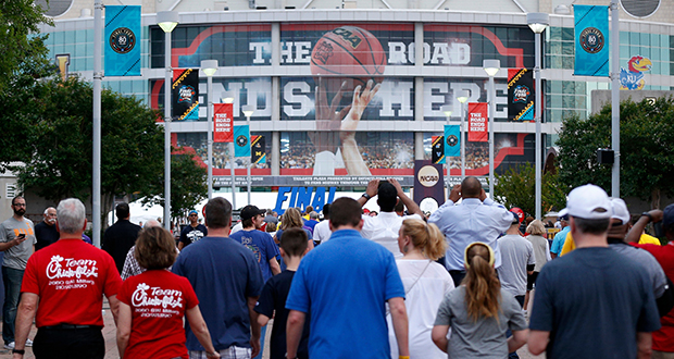 Fans file into San Antonio's Alamodome on April 2 during the NCAA Final Four men's college basketball finals. The financial boost to the Twin Cities when U.S. Bank Stadium hosts next year's Final Four will depend in part on the affluence and enthusiasm of the top teams' fans. (AP photo)