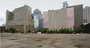 The site of the planned apartments and parking ramp is currently a surface parking lot for Thrivent Financial. Thrivent has said it considers the ramp an important component of the project. (Staff photo: Bill Klotz)