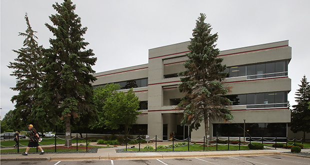 Shamrock Development will continue to be based in the three-story office building at 3200 Main St. NW in Coon Rapids. A trust related to the late developer Jim Stanton sold the property. (Staff photo: Bill Klotz)