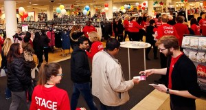 Macy's debuted Minnesota's first Backstage, the brand's off-price store, at its Maplewood Mall location in Maplewood in March. This photo shows Backstage employees passing out scratch-off cards at the grand opening. (AP file photo)