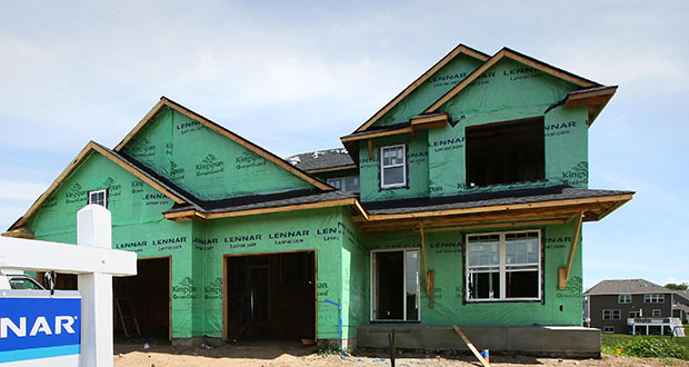 St. Michael has long been a hotbed of single-family housing, including this house under construction at 3872 Mason Ave. NE. A proposed land use category would allow homes on lots not served by city sewer and water. (Staff photo: Bill Klotz)