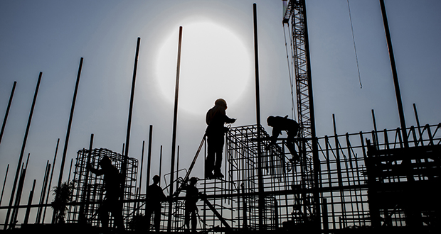The ISQ Global Infrastructure Fund II will make equity investments that average $300 million for energy, utilities, transport and telecommunications projects around the world. In this photo, workers are silhouetted as they prepare reinforcing steel at a construction site at a coal mine in Pakistan. (Bloomberg file photo)