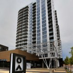 Nordhaus Apartments mixes a white 20-story high-rise with a six-story low-rise composed of brick above 22,000 square feet of retail space.