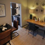 The den area of unit 1551 contains both a work area and a breakfast nook.
