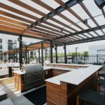 A pergola provides shade for one of the grilling stations on the rooftop deck.
