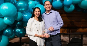 Wearable tech startup HabitAware, co-founded by Aneela Idnani, left, received the grand prize trophy for the 2018 MN Cup on Monday. With her is Scott Litman, co-founder of the entrepreneurship competition. (Submitted photo: MN Cup)
