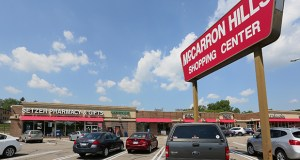 """The area around the intersection of Rice Street and Larpenteur Avenue, which includes the McCarron Hills Shopping Center, for years has not been a priority for the adjoining cities of St. Paul, Maplewood and Roseville, officials admit. A new """"vision plan"""" between the cities and Ramsey County aims to create a more coherent neighborhood across municipal borders. (File photo: Bill Klotz)"""