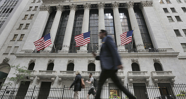 In this June 24, 2016, photo, people walk by the New York Stock Exchange. (AP file photo)