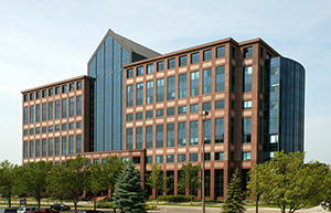 The nine-story, nearly identical office towers at 1600 (shown) and 1550 Utica Ave. S. in St. Louis Park were 84 percent occupied when they sold in October. (Submitted photo: CoStar)