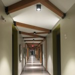 The timber frame motif from Loden SV's lobby is repeated in first-floor hallways. (Staff photo: Matt M. Johnson)