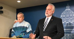 Minnesota State Reps. Gene Pelowski, DFL-Winona, left, and Tony Albright, R-Prior Lake, discuss legislation, in this March 11 picture, to replenish a disaster aid fund ahead of anticipated spring flooding during a news conference at the state Capitol in St. Paul. (AP Photo: Steve Karnowski)