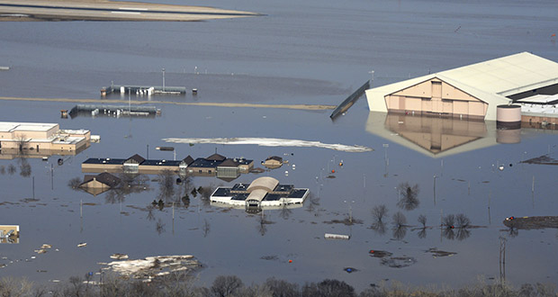 This March 17 photo released by the U.S. Air Force shows an aerial view of Offutt Air Force Base and the surrounding areas affected by flood waters in Nebraska. Surging unexpectedly strong and up to 7 feet high, the Missouri River floodwaters that poured on to much the Nebraska air base that houses the U.S. Strategic Command overwhelmed the frantic sandbagging by troops. (Photo: Tech. Sgt. Rachelle Blake/The U.S. Air Force via AP)