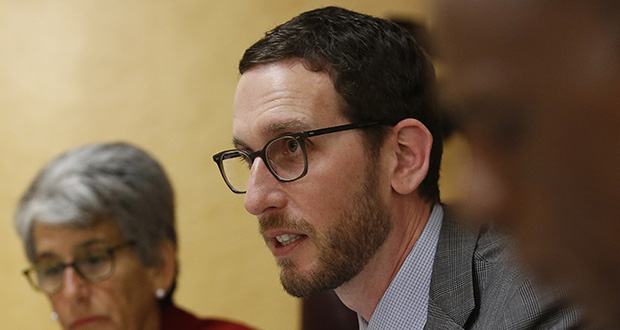 California state Sen. Scott Wiener, D-San Francisco speaks Tuesday at a Senate Public Safety Committee hearing in Sacramento, California. Wiener has proposed increasing housing near transportation and job hubs to help ease the state's housing affordability crisis. (AP Photo: Rich Pedroncelli)