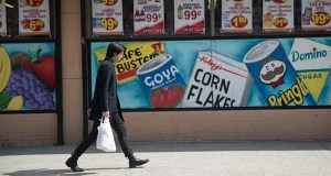 In this March 27 photo, a man leaves a supermarket in the East Village neighborhood of Manhattan. (AP file photo)