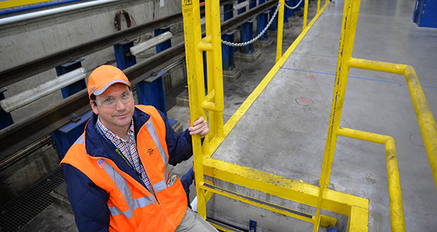This Northstar Commuter Rail maintenance facility in Big Lake is getting a $4 million overhaul. Jeremy Spilde, Metro Transit's manager of commuter rail maintenance, is pictured in the service facility's service pit. (Submitted photo: Metro Transit)