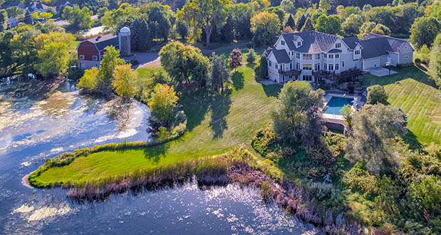 If you have $1 million and change in your house-hunting budget you could have bought this 9,962-square-foot home at 8255 College Trail in Inver Grove Heights. It includes a pool, garage space for 18 vehicles and 7.6 acres of land. (Submitted photo: Biondich Group)