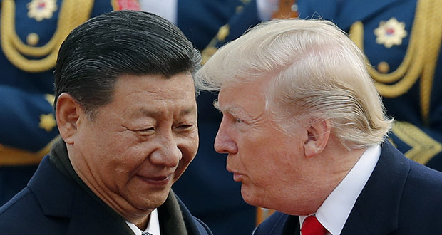 In this Nov. 9, 2017, photo, U.S. President Donald Trump chats with Chinese President Xi Jinping during a welcome ceremony at the Great Hall of the People in Beijing. (AP file photo)