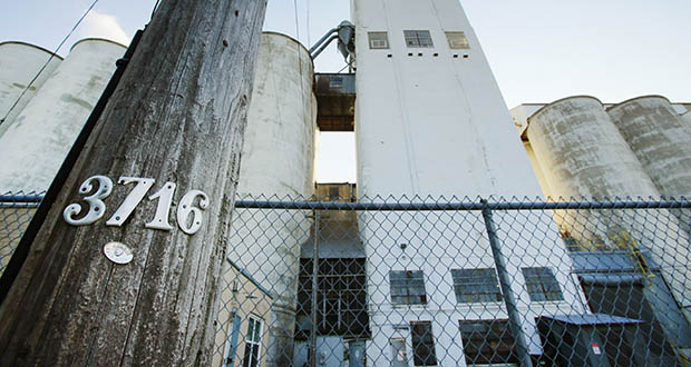 The long-vacant Checkerboard grain elevators at 3716 Dight Ave. now belong to developers Jeff Hall and Sean Sweeney, who plan to build 500 apartments on the site. (File photo: Bill Klotz)