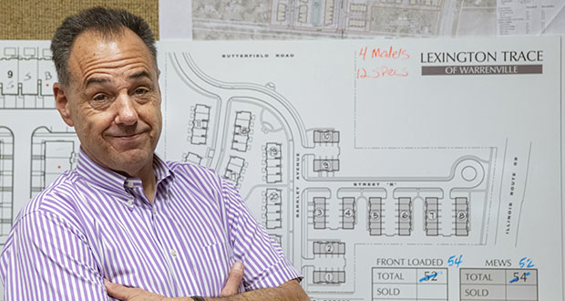Jeff Benach, co-owner of Lexington Homes poses July 16 for a portrait inside his office in Chicago. Lexington Homes, which has townhouse and single-family developments in the Chicago area, has been building smaller projects than in the past, Benach says. (AP photo)
