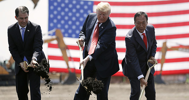In this June 28, 2018, photo, President Donald Trump, center, along with Wisconsin Gov. Scott Walker, left, and Foxconn Chairman Terry Gou participate in a groundbreaking event for the new Foxconn facility in Mount Pleasant, Wisconsin. Wisconsin offered Foxconn over $4 billion in incentives in exchange for a promise to build a high-tech facility that is supposed to create 13,000 jobs. But since the 2017 announcement, the company has failed to meet job targets and even downgraded the type of facility it plans to build. (AP file photo)