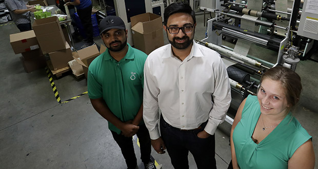 Achyut Patel, director of operations, Rudy Patel, director of business development and Katrina Hart, business development coordinator, pose for a picture July 5 at beyond Green, a maker of biodegradable bags in Lake Forest, California. The company found manufacturing and shipping from India wasn't environmentally friendly enough for a company whose mission is to be green. (AP Photo: Chris Carlson)