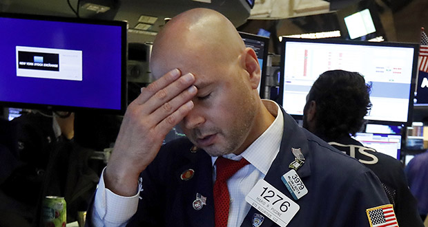 Specialist Mario Picone works on the floor of the New York Stock Exchange on Wednesday. The Dow Jones Industrial Average sank 800 points that day after the bond market flashed a warning sign about a possible recession for the first time since 2007. (AP Photo: Richard Drew)