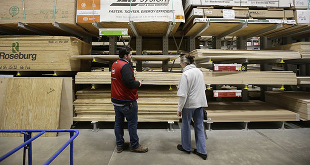 Lowe's said Wednesday that sales at stores open at least a year climbed 2.3% in the second quarter. In this Feb. 23, 2018, photo, Lowe's Assistant Store Manager Patrick Mulloney assists customer Karen Frank at a Lowe's retail home improvement and appliance store in Framingham, Massachusetts. (AP file photo)