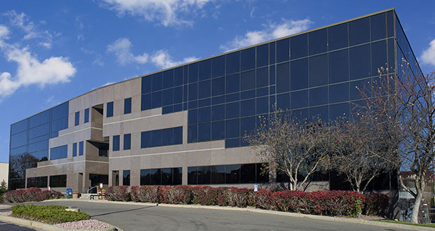 The 46,729-square-foot Willow Creek office building at 9800 Shelard Parkway in Plymouth is one of two properties Redline Property Partners purchased with original 1980s décor intact. (Submitted photo: CBRE)