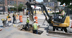 An Xcel crew replaces a gas line running under Sibley Street in downtown St. Paul. The street is due to be reconstructed later this year. (Photo: Bill Klotz/Special for Finance & Commerce)