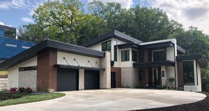 The team at Sustainable 9 + Design worked until the last minute to finish the last details on this new home at 6701 Cheyenne Trail in Edina before it is highlighted at a builders' tour and company party this weekend. (Submitted photo: Sustainable 9 + Design)