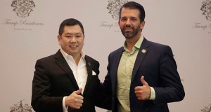 Donald Trump Jr., right, son of U.S. President Donald Trump, and MNC Group President and CEO Hary Tanoesoedibjo give thumb up sign Tuesday as they pose for photographers during a press conference in Jakarta, Indonesia. (AP Photo: Fadlan Syam)