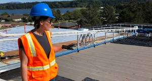 In this July 22 photo, Crystal Sanderson with Portland-based Yost Grube Hall Architecture, shows reporters an emergency access ramp that is being built alongside Oregon State University's Marine Studies Building, which is under construction in Newport, Oregon. The roof will serve as a vertical evacuation zone for almost 1,000 fleeing a tsunami that an offshore quake would generate, and the ramp will be open around the clock. (AP Photo: Andrew Selsky)