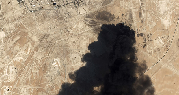 In this Saturday, Sept. 14, 2019 file photo, a satellite image from Planet Labs Inc. shows thick black smoke rising from Saudi Aramco's Abqaiq oil processing facility in Buqyaq, Saudi Arabia. (Planet Labs Inc via AP, File)