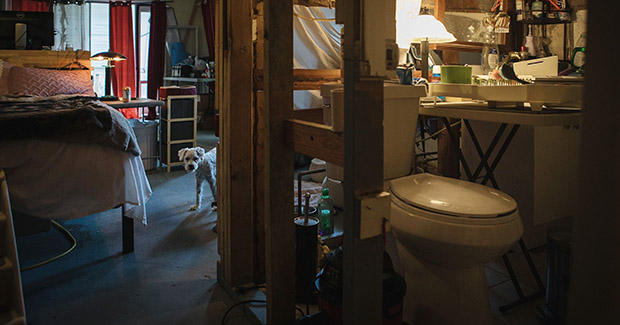 Lori Rittel installed a sink in the bathroom, which is missing a wall, so she can wash her dishes inside her house that was extensively damaged by Hurricane Irma two years ago. (Bloomberg photo: Jayme Gershen)