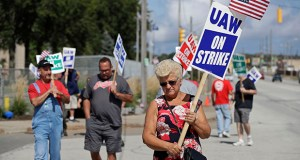 Mara Paulic, a 42-year GM employee, pickets outside the General Motors Fabrication Division on in Parma, Ohio. The strike against General Motors by 49,000 United Auto Workers entered its second week Monday with progress reported in negotiations but no clear end in sight. (AP Photo: Tony Dejak)