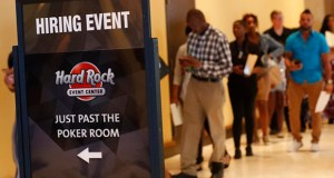Job applicants line up June 4 at the Seminole Hard Rock Hotel & Casino Hollywood during a job fair in Hollywood, Florida. The Labor Department said Tuesday that the number of U.S. job openings declined for the second consecutive month in July. (AP file photo)