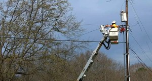 Jordan Demartino works to connect power from a transformer March 21 in Simpsonville, South Carolina, to a new light pole across the street. She admits customers often do a double-take when seeing a woman arrive at their door. (AP Photo/Sarah Blake Morgan)