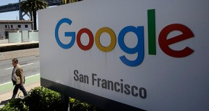 A group of states announced an investigation into Google on Monday to determine whether the tech company has become too big. In this May 1 photo, a man walks past a Google sign outside with a span of the Bay Bridge at rear in San Francisco. (AP file photo)